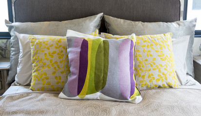 Colorful pillow on bed
