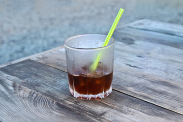 Fresh Cold Cola with ice in glass