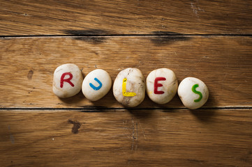 rules paint on stone on the wood