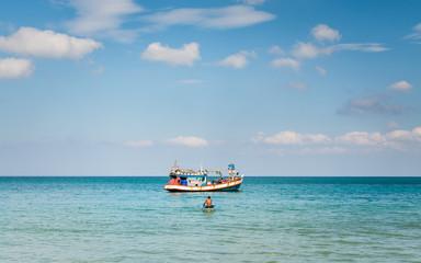 A man paddling a little boat