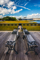 Benches on the fishing pier in Charleston, South Carolina.