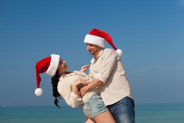Christmas couple on a beach