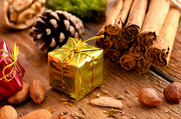 Christmas Present / Nuts and Cinnamon Sticks on Wood