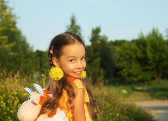 Happy little girl having fun outdoors