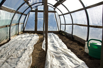 greenhouse hothouse in early spring after vegetable seeding