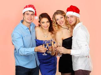 company enjoys Christmas.  Company of friends in Santa caps