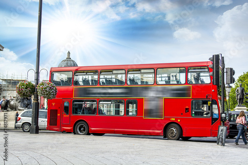 The red double decker bus. Poster