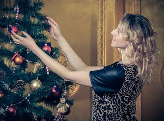 Beautiful  girl  near the Christmas tree