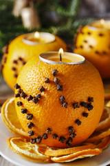Orange pomander ball with candle. Christmas decor