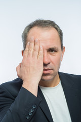 Businessman covering his face with both hands