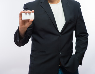Businessman showing the blank card in hand