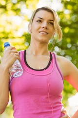 Fit blonde holding her water bottle