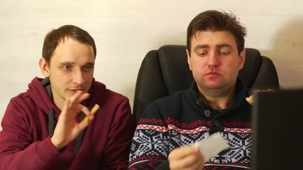 Business partners discussing strategy eating fast food