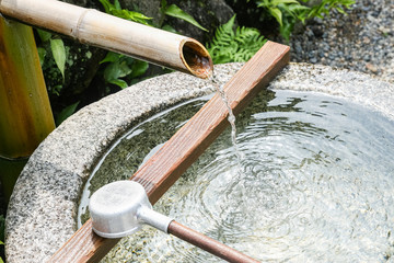 wash site besides a japanese temple for people washing hands