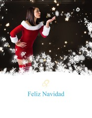 Composite image of pretty girl in santa outfit blowing
