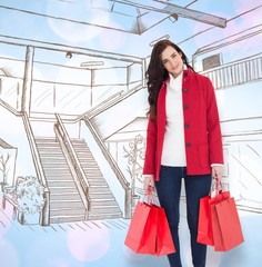 Smiling brunette in winter clothes holding shopping bags