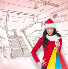 Brunette in winter clothes holding shopping bags