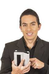 handsome young man wearing a suit posing using tablet