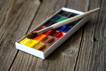box of professional watercolor on wood background