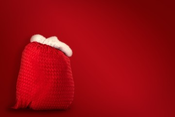 Composite image of santas red bag standing alone