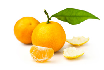 ripe tangerines with fresh leaves