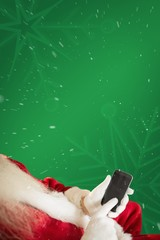 Composite image of santa using smartphone