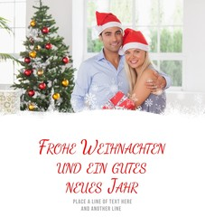 Composite image of happy couple at christmas