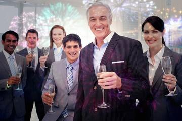 Smiling inernational business team holding glasses of chamoagne
