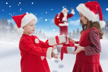 Composite image of cute siblings with gifts