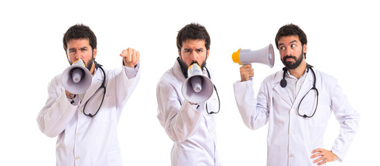 Doctor shouting over isolated white background