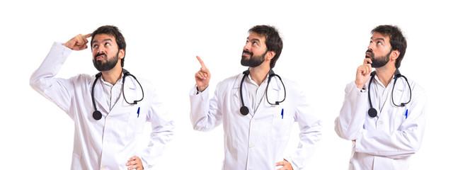 Doctor thinking over isolated white background
