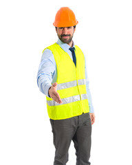 Worker making a deal over white background
