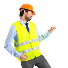 workman making guitar gesture