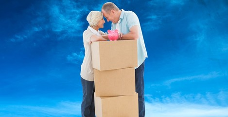 Older couple smiling at each other with moving boxes
