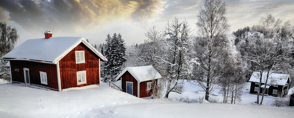 old rural cottages in a snowy winter landscape, panoramic view