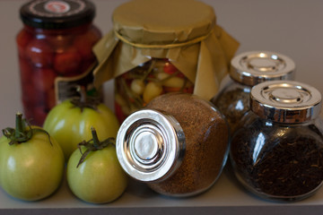Still life composition with picle, spice and green tomatos