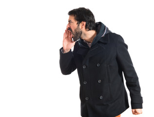 Man shouting over white background