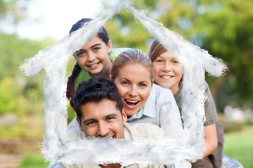 Composite image of happy family in the park