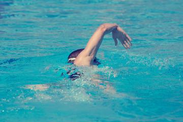 Slim sportsman swimming.