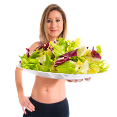 Sport woman holding a salad