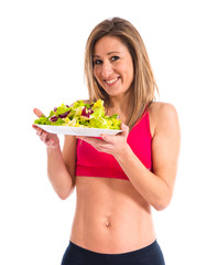 Sport woman holding a salad