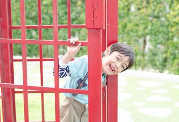 Little  boy smiling out off the door