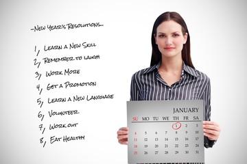 Composite image of businesswoman holding a calendar