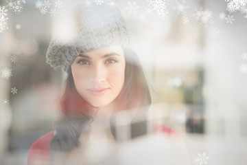 Composite image of portrait of a pretty brunette in grey hat