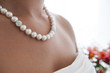 bride wearing pearls necklace - 74830505
