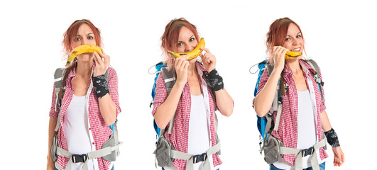 backpacker talking by banana over white background