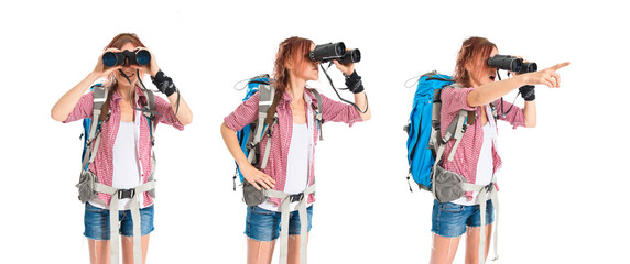 girl looking through binoculars over white background
