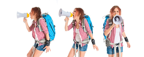 backpacker shouting by megaphone over white background