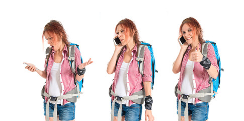 backpacker talking to mobile over white background