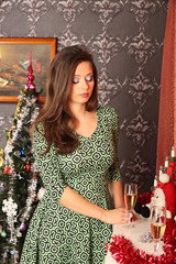 beautiful woman near the fireplace in winter house